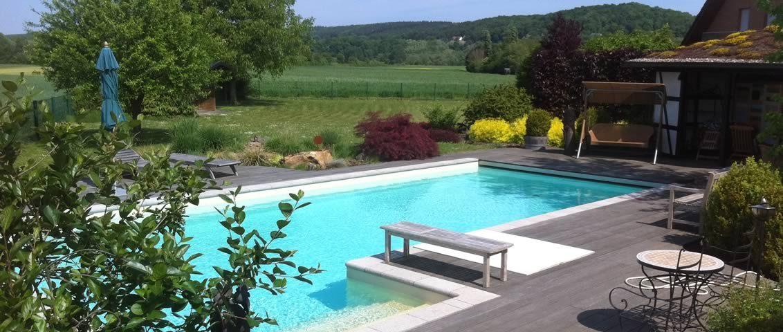 Referenz swimming pool Schwimmbad Gartengestaltung Kalisch